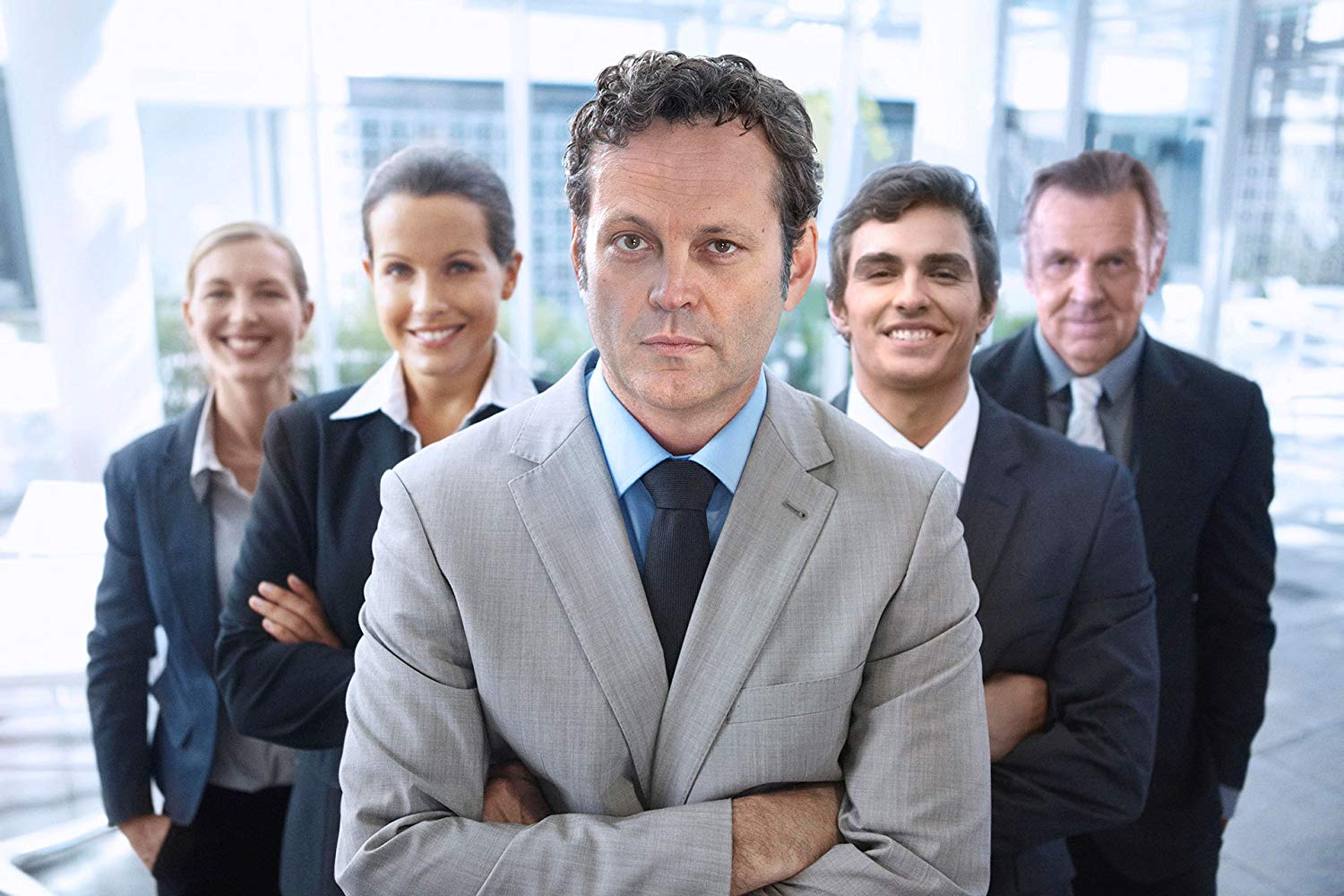 Vince Vaughn and the cast of Unfinished Business posing for every generic stock photo ever.